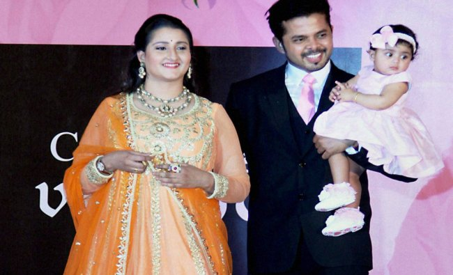 S Sreesanth with his wife Bhuvaneshwari Kumari and daughter Sree Sanvika during the fashion show...