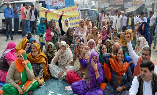 Jat community people block a road in Gurgaon during their agitation for reservation...
