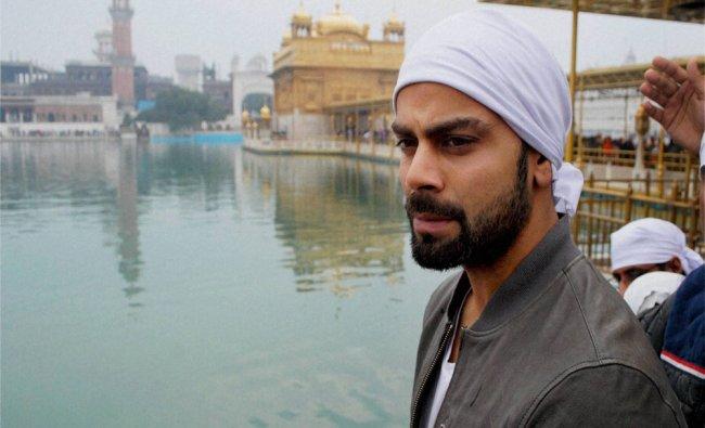 Cricketer Virat Kohli paying obeisance at Golden Temple in Amritsar on Friday...