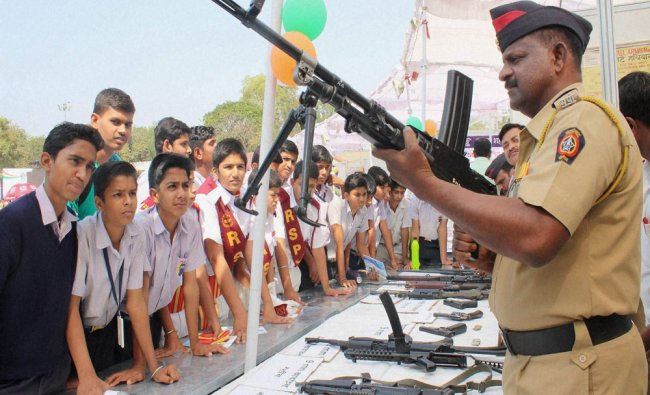 Students looking at arms during \'Tantra\' the Tech Expo 2016 exhibition...