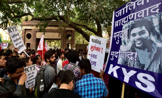 Students and activists from various organizations shout slogans during their protest at Delhi...