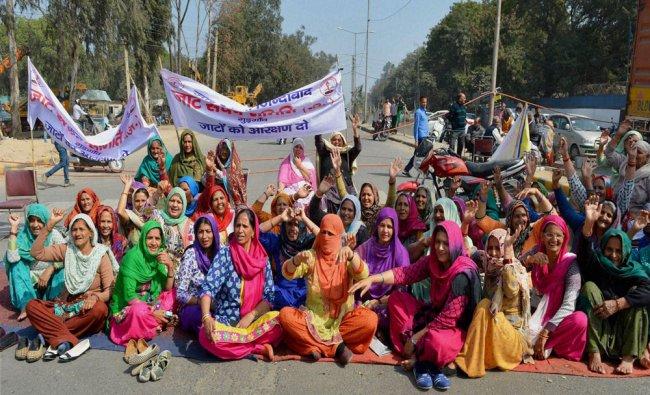 Women of Jat community jam the old Delhi road at Atul Kataria chowk road in Gurgaon...
