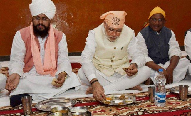 Modi taking \'Guru ka Langar\' at Shri Guru Ravidass Janam Asthan Mandir, Seer Goverdhanpur...