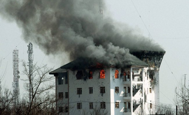 Smoke rising from the top floor of the JKEDI building where militants were holed up...