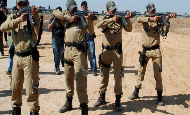 Delhi Police commando who aims at a target fire range after the Inauguration of Long Firing Range...