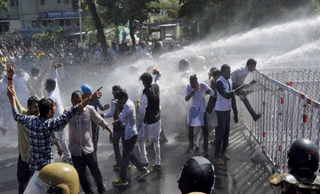Police uses water cannons to disperse NSUI activists during their protest at Madhya Pradesh...