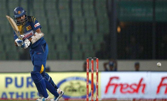 Sri Lankan cricketer Tillakaratne Dilshan plays a shot during the Asia Cup Twenty20 international ..