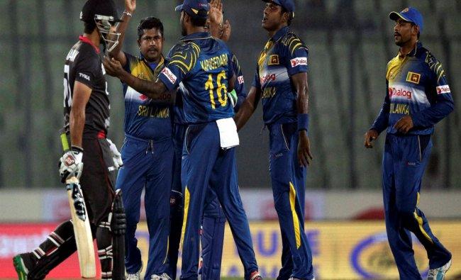 Sri Lankan bowler Rangana Herath celebrates the dismissal of United Arab Emirates...