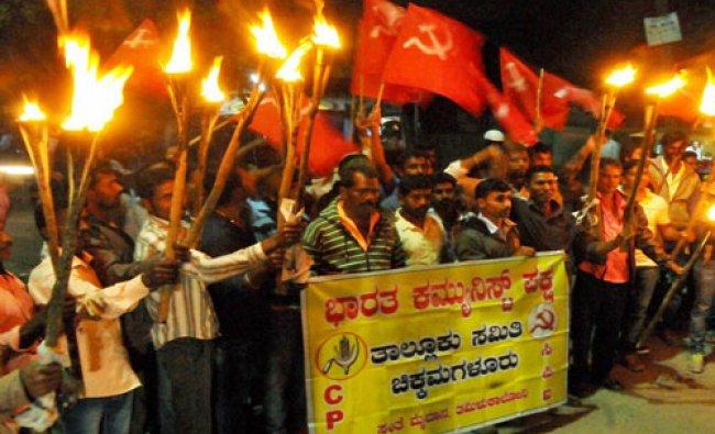 CPI activists carried torch parade demanding for release of JNU student Kanhaiya Kumar arrested ...