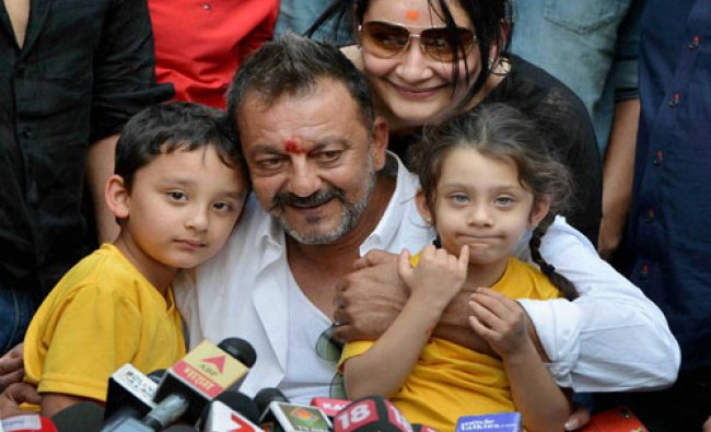 Actor Sanjay Dutt with his wife Manyata and children Shahran and Iqra in a press conference at his..