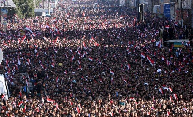 Followers of Iraq\'s influential Shiite cleric Muqtada al-Sadr chant slogans...