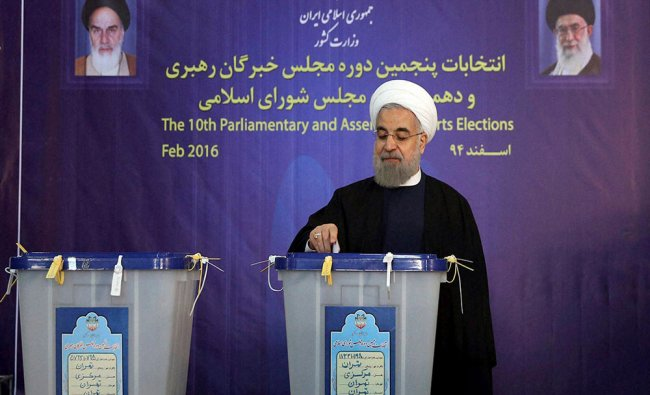President Hassan Rouhani casts his ballot for parliamentary elections in Tehran...