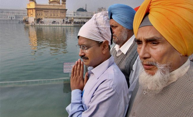 Arvind Kejriwal with other party leaders paying obeisance at Golden Temple in Amritsar...