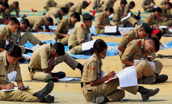 NCC students attend the C certificate written examination at NCC ground in Allahabad ...