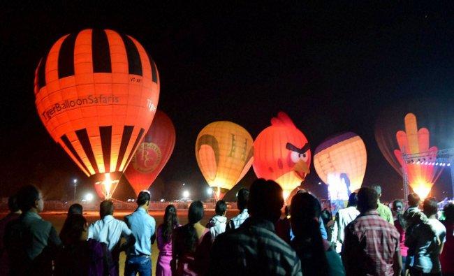 People enjoying \'Hot Air Balloon Night Glowing\' during Bhoj Adventure Fest in Bhopal...