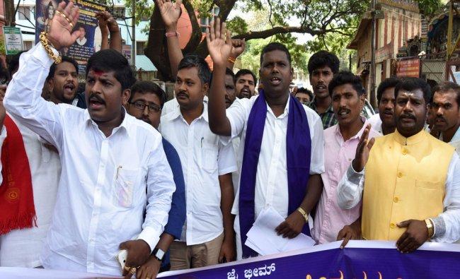 Students Federation staging protest demanding dismiss of Bangaluru University Registrar...