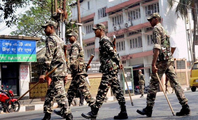 Security personnel keep vigil in front of Deputy Commissioner Office ahead of Assam state Assembly..