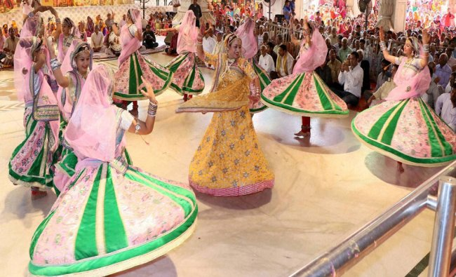 Artists perform during the Fag Utsav celebration at a Temple in Jaipur...