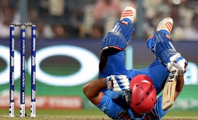 Afghanistan batsman Samiullah Shinwari fails down on the ground to plays a shot during ICC T20...