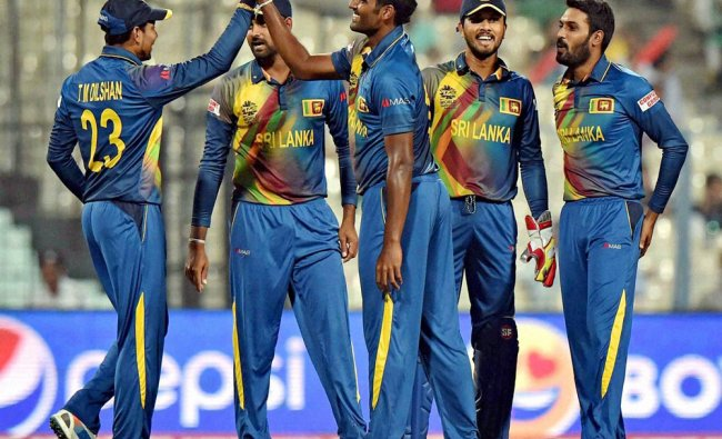 Sri Lankan bowler Perera celebrates with his teammate after taking a wicket during an ICC ...