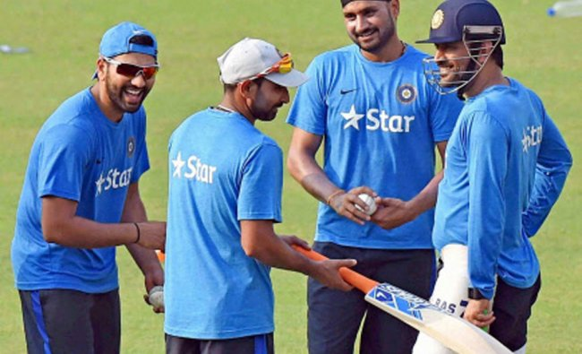 Indian cricketers during a practice session at the Eden Gardens in Kolkata ...