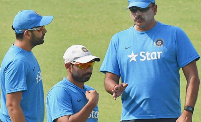 Mohammed Shami Rohit Sharma and coach Ravi Shastri during Indian team\'s practice session...