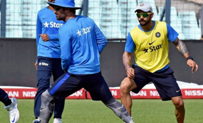 Indian cricketers play soccer during a practice session at the Eden Gardens...