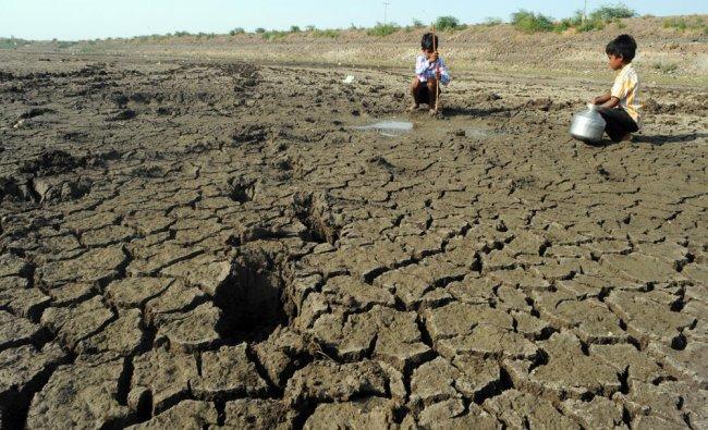 Children are seen digging the land on the dried Kere Bosga lake near Kalburgi...