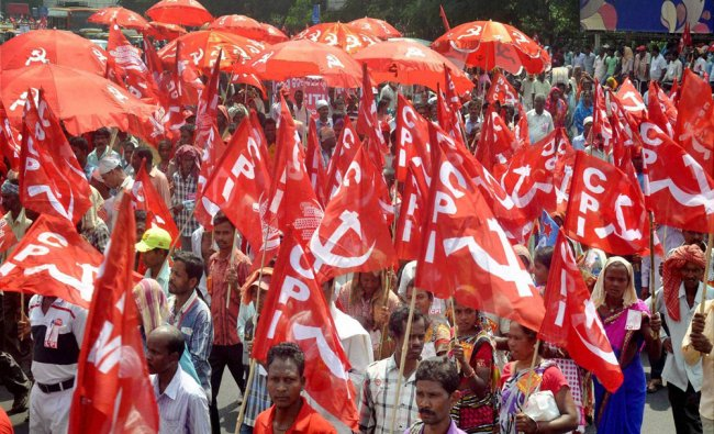 Workers of Communist Party of India taking part in a protest rally against price rise...