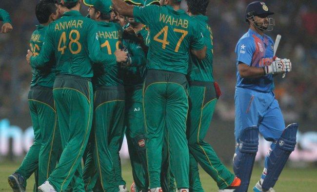 Pakistan\'s players celebrate the dismissal of India\'s Suresh Raina...