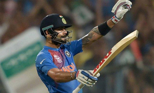 Virat Kohli celebrates after completing his half century against Pakistan during the ICC T20...