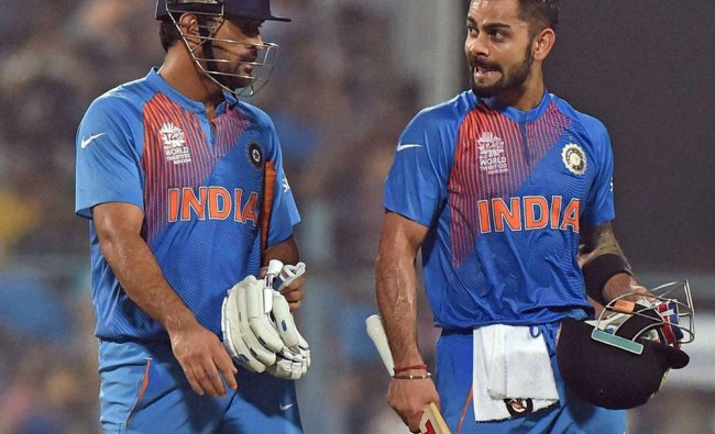 Indian captain M S Dhoni and Virat Kohli after beating Pakistan by 6 wickets during the ICC...