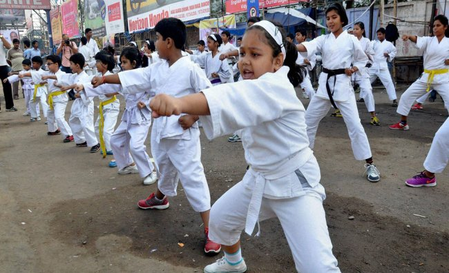 Kids showing their martial arts skills during the observance of \'Rahagiri Day\' in Ranchi...