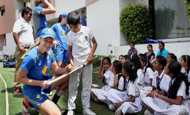Australian women cricket team players giving autographs to the students...