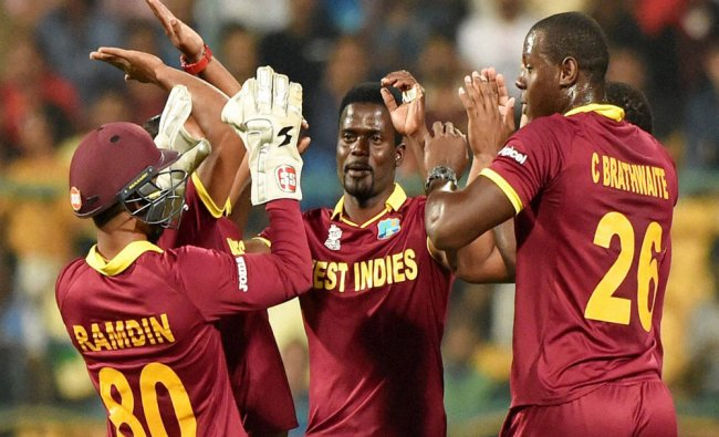 West Indies cricketers celebrate the wicket of Dinesh Chandimal of Sri Lanka during the ICC World ..