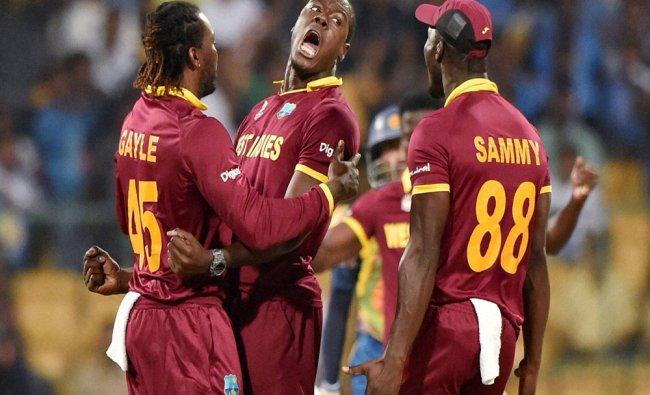 West Indies bowler Carlos Brathwaite celebrates the wicket of Tilakratne Dilshan of Sri Lanka...