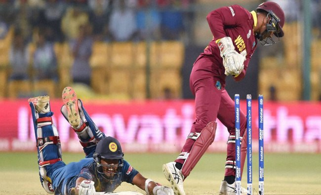 West Indies Wicket keeper Denesh Ramdin runs out Dinesh Chandimal of Sri Lanka during the ICC World.