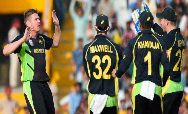 Australian player James Faulkner with team mates celebrating the wicket of Sharjeel Khan of Pakistan