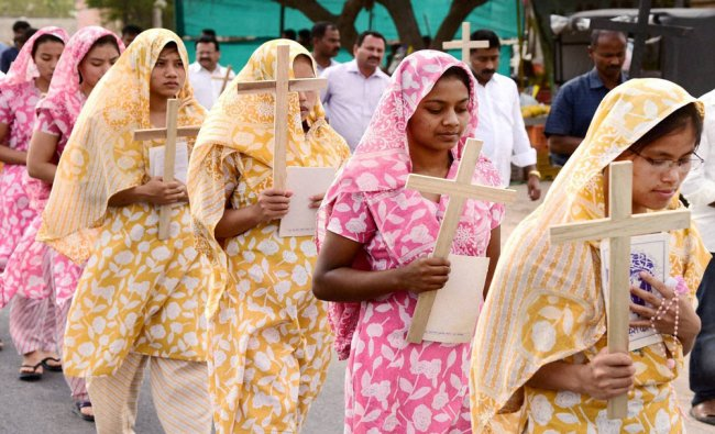 Christians take part in a procession to mark \'Good Friday\' in Bikaner...