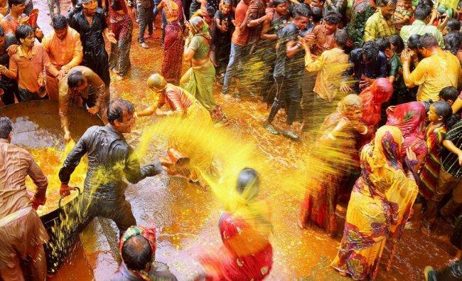 People playing Kodamar Holi at Beawar in Rajasthan on Friday...