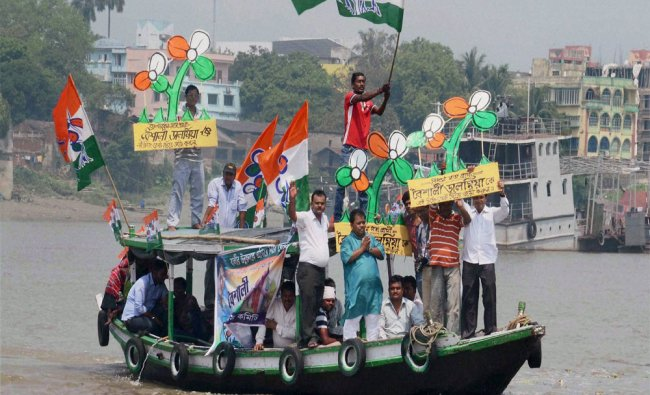 Trinamool Congress supporters at an election campign on a boat at Belur Muth area...