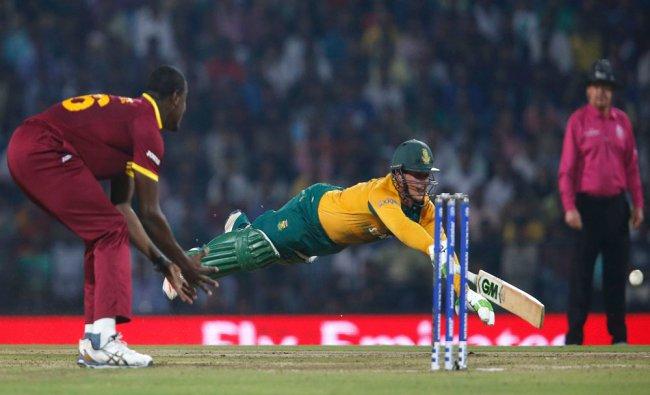 South Africa\'s Quinton de Kock dives to make his crease...