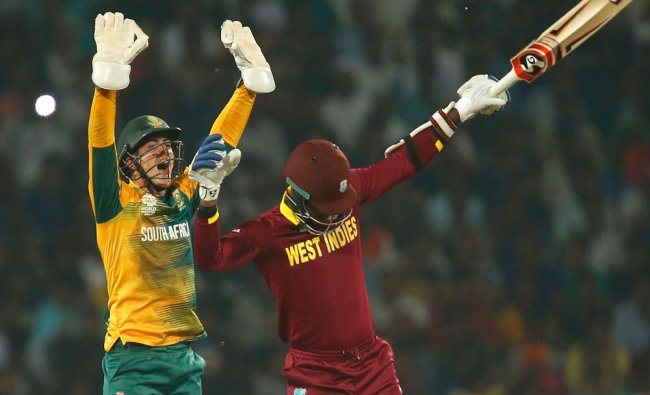 South Africa\'s wicketkeeper Quinton de Kock (L) appeals unsuccessfully for the wicket of West Indies