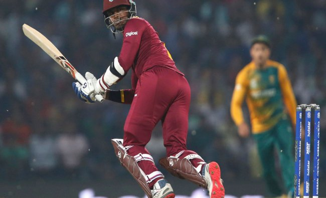 West Indies Marlon Samuels watches the ball after playing a shot...