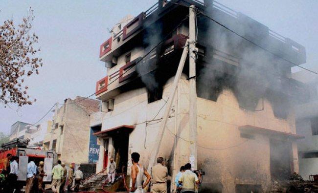 Firefighters dousing a fire at Sanjay Gandhi Transport Nagar in New Delhi on Wednesday...