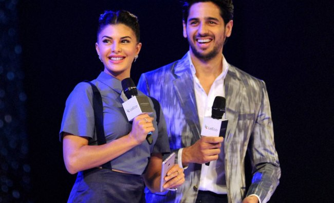 Bollywood actor Jacqueline Fernandez with Siddharth Malhotra during a launch event...