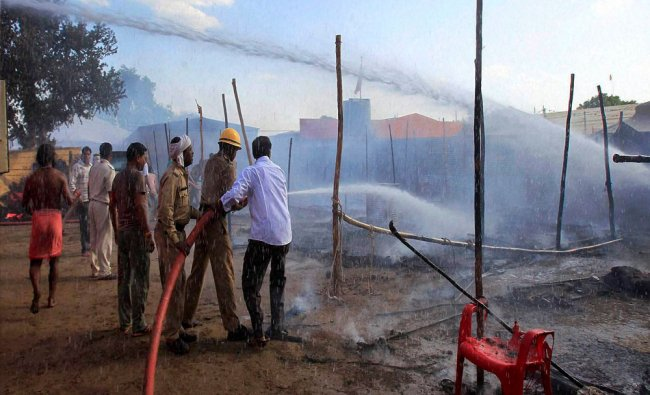 Firefighters trying to extinguish a fire at Simhastha Mahakumbh in Ujjain...