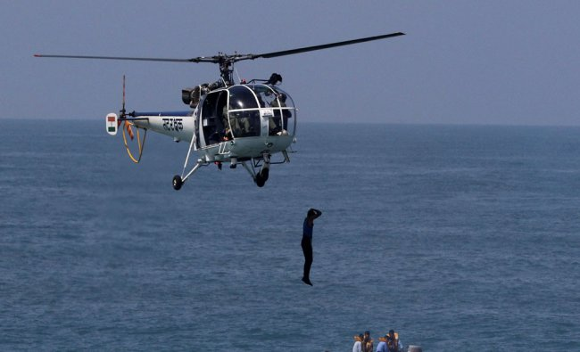 Indian coast guard personnel participate in a mock drill during the National Maritime Search...