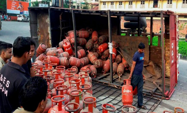 A truck loaded with LPG cylinders overturns after the driver lost his control at Ambari area...