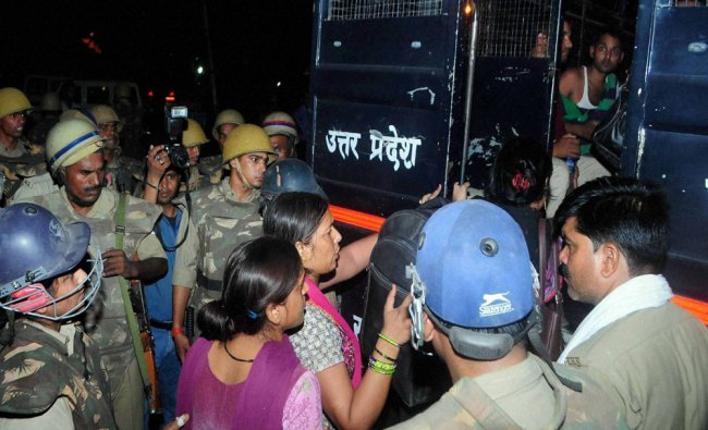 Policemen arrest TET aspirants for protesting against UP government for their recruitment...